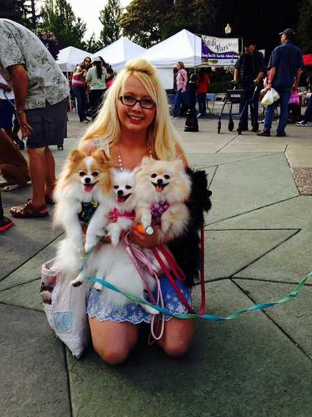 Janae Snyder came to the parade with her four Pomeranians: Bentley, Bella, Lacie and Lily. Her mom, brother and grandma came along to help her wrangle the foursome.
