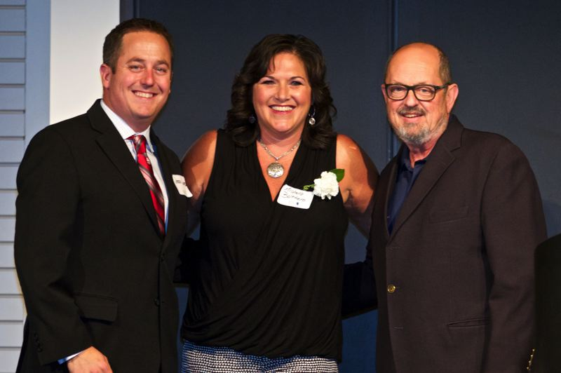 by: TIMES PHOTO: JAIME VALDEZ - Michele Bottaro poses for a picture with Jerry Jones, chairman of the Beaverton chamber board, and Beaverton Mayor Denny Doyle after accepting the Outstanding Individual Award on behalf of her mother, Patricia Reser.