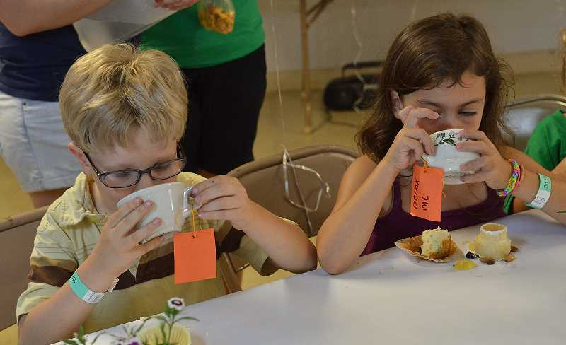 by: TIDINGS PHOTO: VERN UYETAKE - Six-year-old campers Elva Karls, right, and Dylan Ryan enjoy drinking their tea.