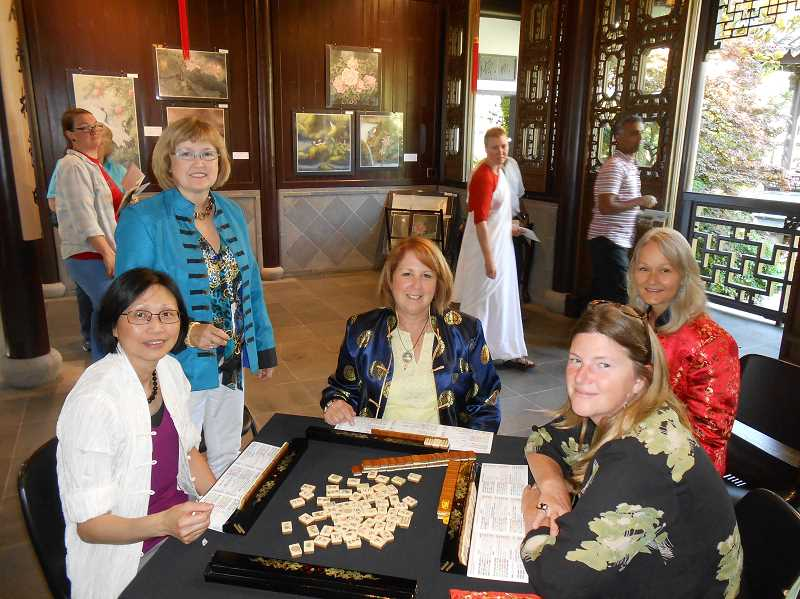by: REVIEW PHOTO: CLIFF NEWELL - Members of the Lake Oswego Mah Jongg Club find themselves objects of fascination to tourists at Lan Su Chines Gardens. From the left are Selina Lo, Lilly Logan, Laura Campbell, Nicole Rhoads, and Rebekah Claeys.
