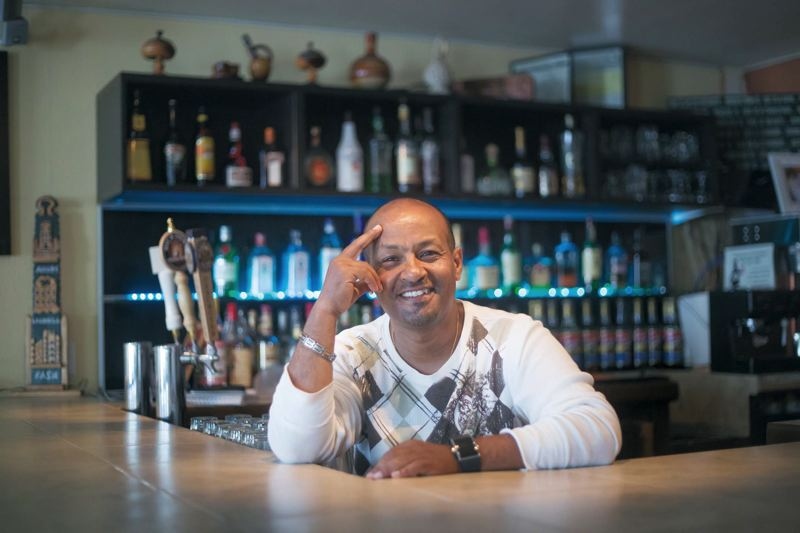 by: TRIBUNE PHOTO: JONATHAN HOUSE - When Betre Peter Tesfu opened an Ethiopian restaurant on Southeast Division and 50th six years ago, the neighborhood was hurting financially. Now its bracing for gentrification.