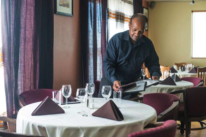 by: TRIBUNE PHOTO: JONATHAN HOUSE - Despite its funky upstairs location, Bete-Lucas Ethiopian Restaurant is thriving off 50th and Division. Co-owner Betre 'Peter' Tesfu and his wife are looking for sites to open a breakfast cafe.