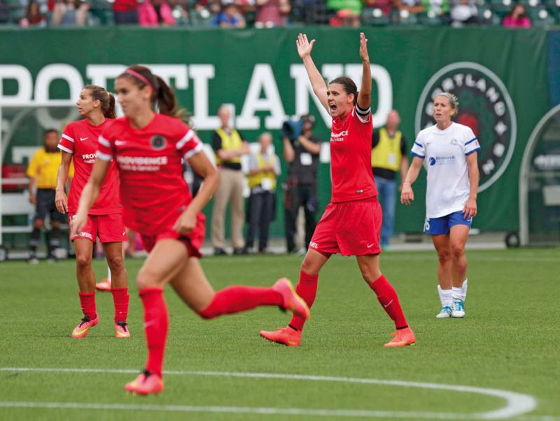 by: TRIBUNE PHOTO: JONATHAN HOUSE - Christine Sinclair of the Portland Thorns looks to the referee for a foul call in a recent home match against FC Kansas City.
