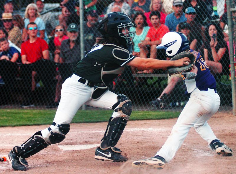 by: DAN BROOD - TAGGED -- Tigard catcher Kolby Shimojima (left) tags out Hermiston's Sam Schwirse.