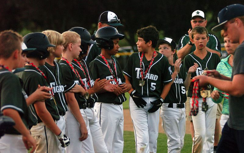 by: DAN BROOD - The Tigard Little League 10-11 all-stars with the second-place medals.