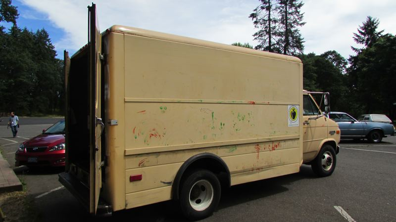 by: MARK MILLER - The aged, paint-spattered van used by the St. Helens School District to bring food to and from McCormick Park for its summer food service program. Misty Crawford, director of nutrition, said the district receives no funding to buy new vehicles for the program.