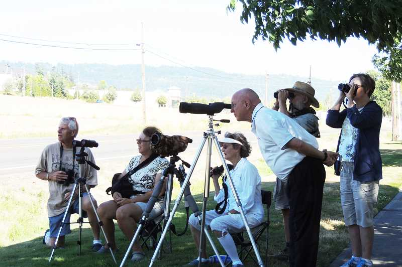 Photo Credit: HILLSBORO TRIBUNE PHOTO: DEBBY DE CARLO - Dennis Manzer (center) has drawn hundreds of curious onlookers to the spot near 185th Avenue and West Union Road, where he set up a few spotting scopes to wait for an eaglets first flight.