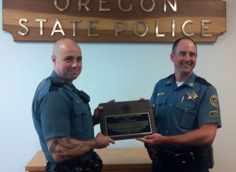 by: PHOTO COURTESY OREGON STATE POLICE - (Left) Trooper Jamison Goetz receives the Harold Berg Lifesaving Award from OSP Captain Andy Heider in a July 24 ceremony.