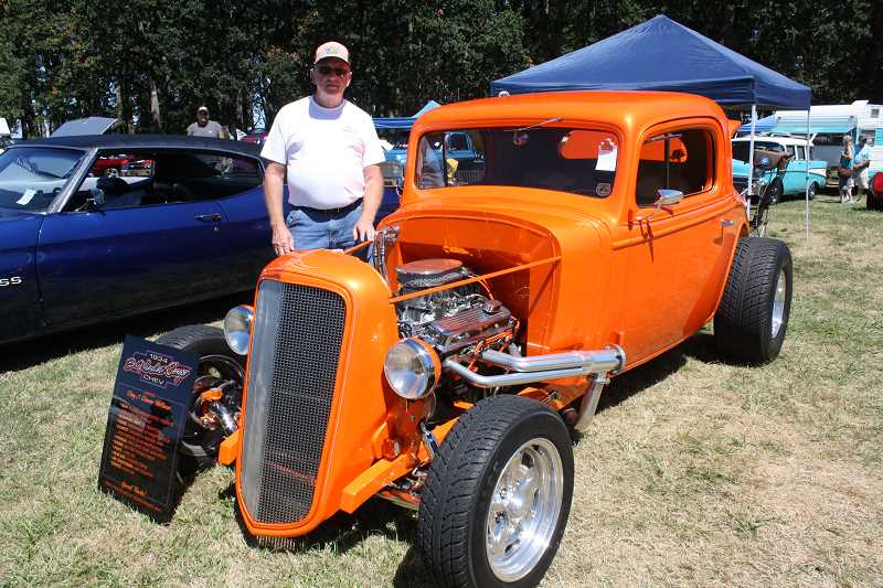 by: PEGGY SAVAGE - Owner Doug Wellman, of Molalla, with his 1934 Chevy Coupe, which won the Molalla Pioneer Award in the Cruise In Saturday