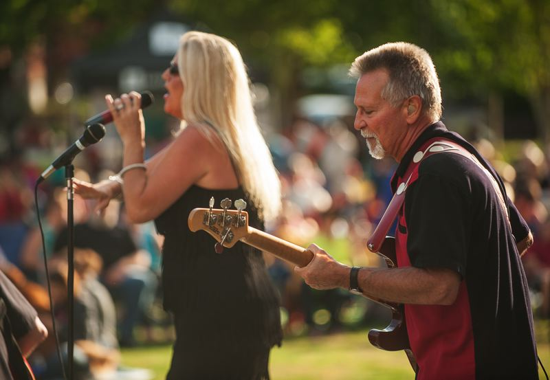 by: SPOKESMAN PHOTO: JOSH KULLA - Lugnuts' bassist Matt Kenney backs up vocalist Barbara Cecil July 24 at Wilsonville's Town Center Park.