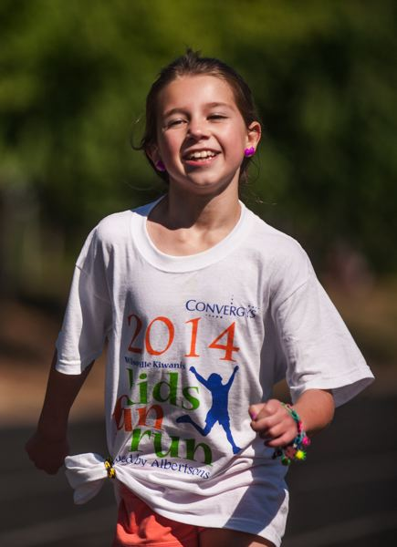 by: SPOKESMAN PHOTO: JOSH KULLA - The 2014 Wilsonville Kiwanis Kids Fun Run was held July 26 under clear skies and perfect conditions, as local Kiwanians hosted their biggest event of the year at Wood Middle School.