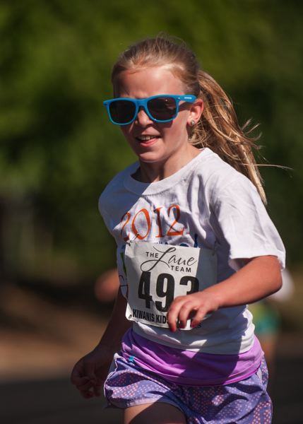 by: SPOKESMAN PHOTO: JOSH KULLA - Sunglasses were the order of the day July 26 at the Wilsonville Kiwanis Kids Fun Run at Wood Middle School.