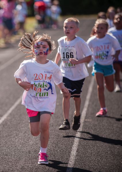 by: SPOKESMAN PHOTO: JOSH KULLA - Facepainting and running go well together at the Wilsonville Kiwanis Kids Fun Run.
