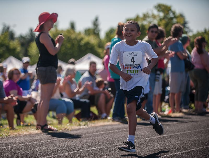 by: SPOKESMAN PHOTO: JOSH KULLA - A happy participant takes part in the July 26 Wilsonville Kiwanis Kids Fun Run.