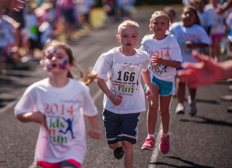 by: SPOKESMAN PHOTO: JOSH KULLA - Kids approach the finish line July 26 at the Wilsonville Kids Fun Run.
