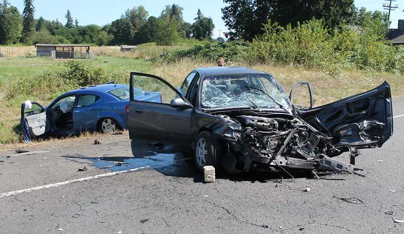 by: JIM BESEDA/MOLALLA PIONEER - A Kia Spectra (right) traveling southbound on Highway 213 Monday afternoon apparently crossed over the center line, grazed an oncoming dump truck and then collided head on with a northbound Dodge Avenger about 3:25 p.m. near South Macksburg Road and the Liberal Country Store.