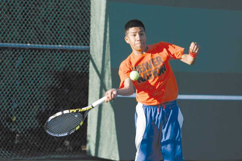 by: PHIL HAWKINS - Woodburn High School's Adrian Salinas returns a serve from teammate Marco Soria in the opening match of the 37th Woodburn Open Friday. Salinas lost to Soria, but went on to claim the 3.0/3.5 singles consolation title.