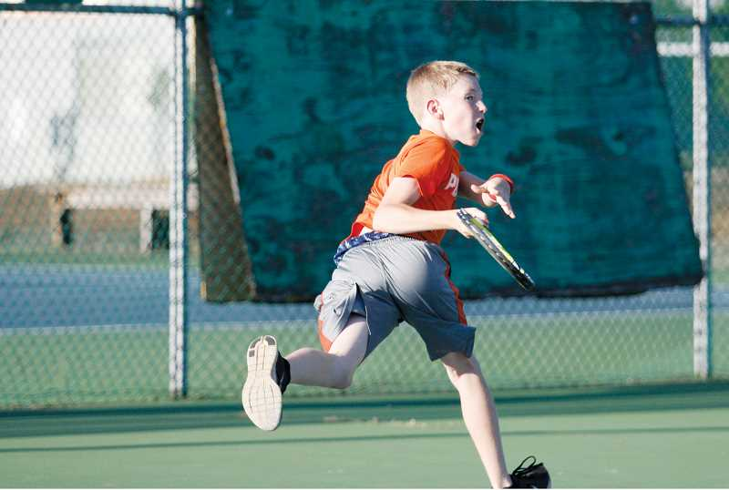 by: PHIL HAWKINS - Salem father-and-son duo Connor Towery (above) and Travis Towery (below) won the consolation finals of the doubles tournament Sunday. Travis Towery also enrolled in the singles open, where he lost in straight sets to tournament organizer and Woodburn tennis coach Tom Lonergan.