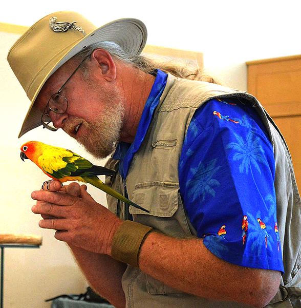 by: CONTRIBUTED PHOTO - The Oregon Bird Man, a.k.a. Karl Anderson, with his Sun Conure, Nacho. The bird orginates from South America.
