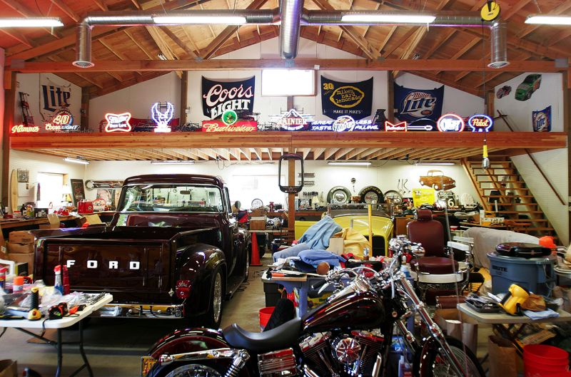 by: OUTLOOK PHOTO: JIM CLARK - Muck's barn is filled with vintage classics, neon beer signs and other collectibles.