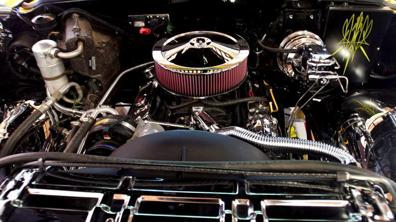 by: OUTLOOK PHOTO: JIM CLARK - Under the hood of the yellow Silverado pick-up is a 91' Chevy fuel-injected cop motor engine.