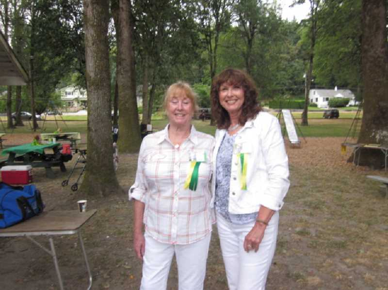 Photo Credit: SUBMITTED PHOTO - Carol Latourette, left, and Cash Latourette are two of the volunteers who make the annual alumni picnic happen. Dottie Larsen, right, is the event's co-chairwoman.