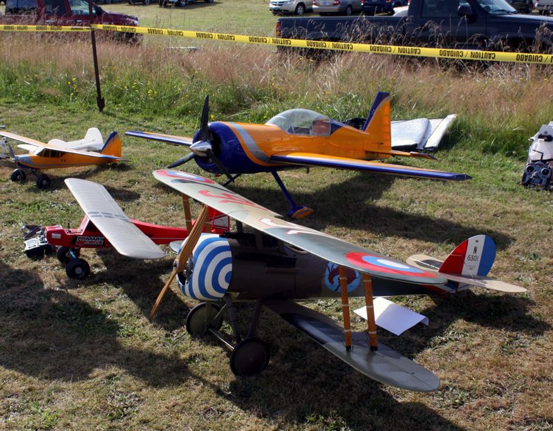 by: POST PHOTO: KYLIE WRAY - RC planes can be bought in many different varieties. One of Bacons preferred planes, front, is a WWI modal made here in Sandy.