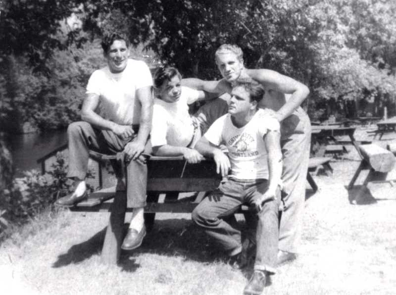 by: COURTESY OF GINO DAMICO - THANKS FOR THE MEMORIES - At Roamers Rest, Gino Damico (upper right) poses with friends and family on a picnic bench next to the Tualatin River in the late 1940s.