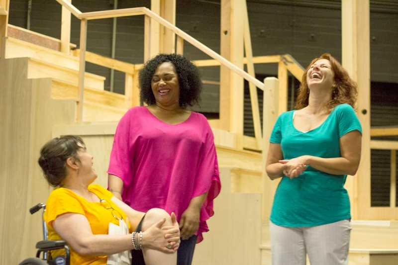 by: LACEY JACOBY/FOR PAMPLIN MEDIA GROUP - WAY-TOO-FUN REHEARSAL -  During a rehearsal at the Broadway Rose New Stage, with a 'Best Little Whorehouse in Texas' set under construction behind them, newcomer Carmen N. Brantley-Payne (center) shares a laugh with Sharon Maroney (left) as the wheelchair-riding Miss Mona and director Peggy Taphorn.
