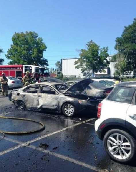 by: SUBMITTED PHOTO: TVF&R - Tualatin Valley Fire & Rescue officials say three cars were damaged and two destroyed after an afternoon fire in Tigard.