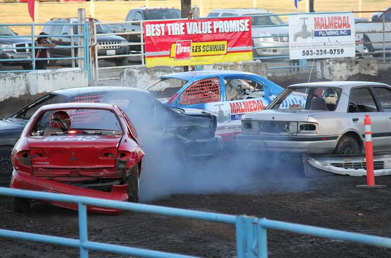 Photo Credit: NEWS-TIMES PHOTO: STEPHANIE HAUGEN - The demolition derby packed the stands Friday night.