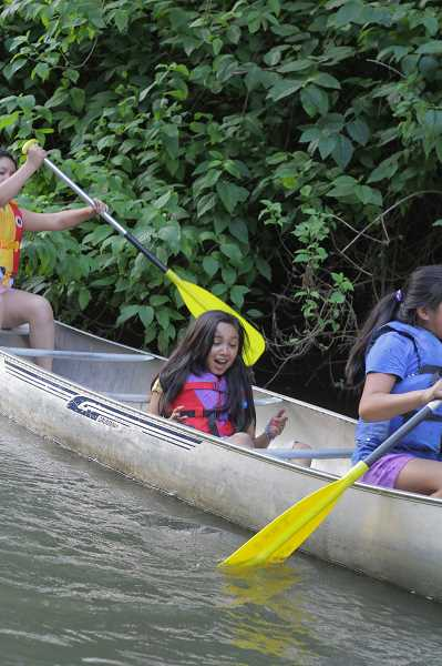 Photo Credit: NEWS-TIMES PHOTOS: DAVID ROZA - Seventy girls from the Adelantas Chicas summer camp program took turns kayaking and canoeing on the Tualatin River at Rood Bridge Park in Hillsboro last Friday. The Tualatin Riverkeepers provided the canoes, kayaks and supervisors.