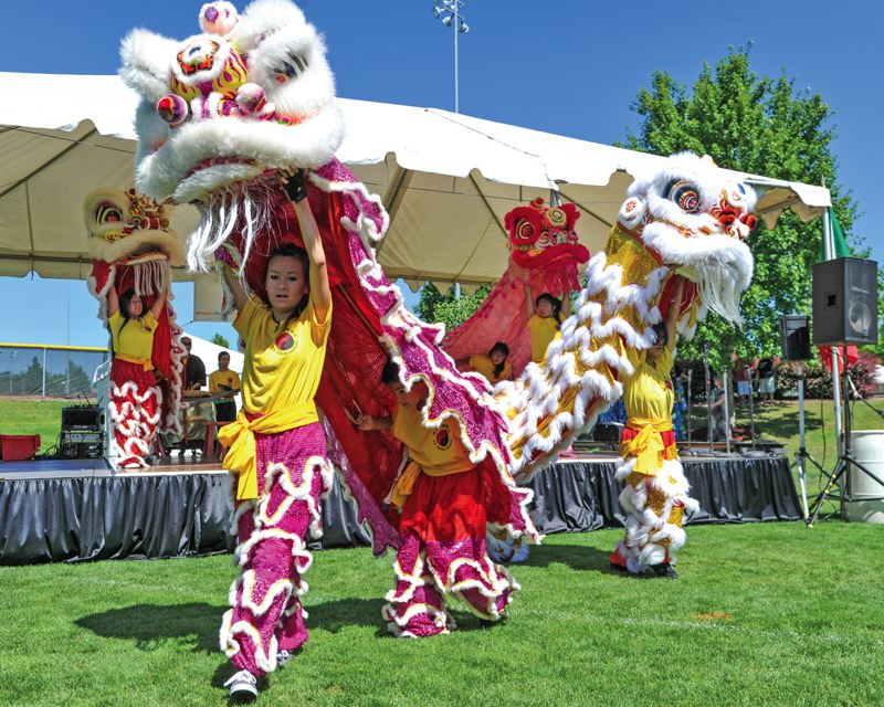 by: TIMES PHOTOS: JOHN LARIVIERE - Members of the Northwest Dragon and Lion Dance Association perform during the Beaverton International Celebration at the Howard M. Terpenning Recreation Complex.
