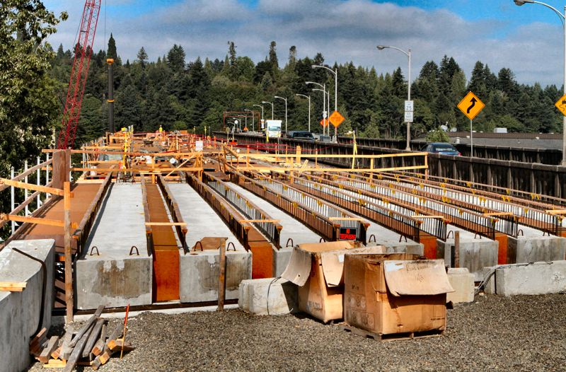 by: DAVID F. ASHTON - A first look at where youll be driving, in a year or so! Workers have been building forms between the concrete girders for the new eastside approach of the new Sellwood Bridge.