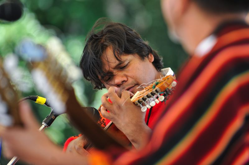 by: TIMES PHOTOS: JOHN LARIVIERE - Tito Amaya of Chayag, an Andean folk music group, plays the Charango during a performance as part of the Beaverton International Celebration.