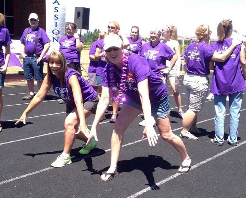 by: CONTRIBUTED - Michelle Gipple and Shawna Lippert take part in the 2014 Estacada Relay for Life.