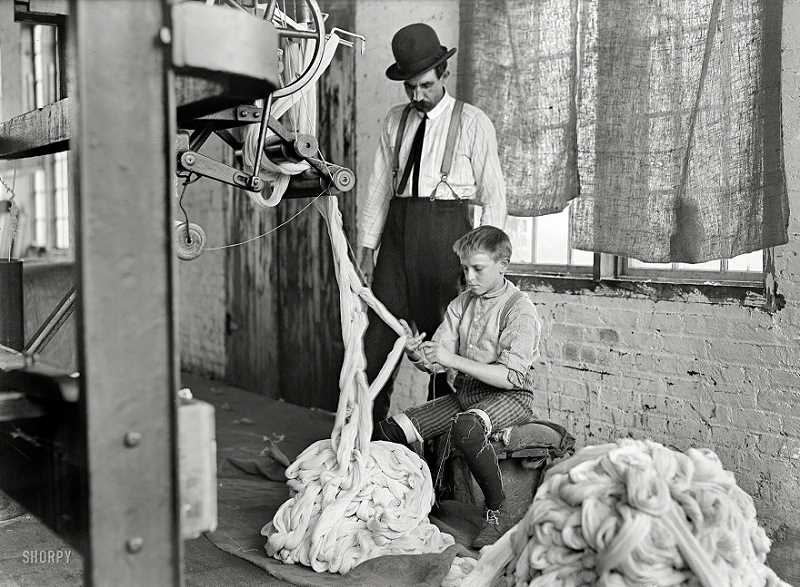 by: SUBMITTED PHOTO: LEWIS HUNT (PUBLIC DOMAIN) - Lewis Hunt took this picture of a boy at work in a cotton mill in Newton, N.C. in the early 1900s.
