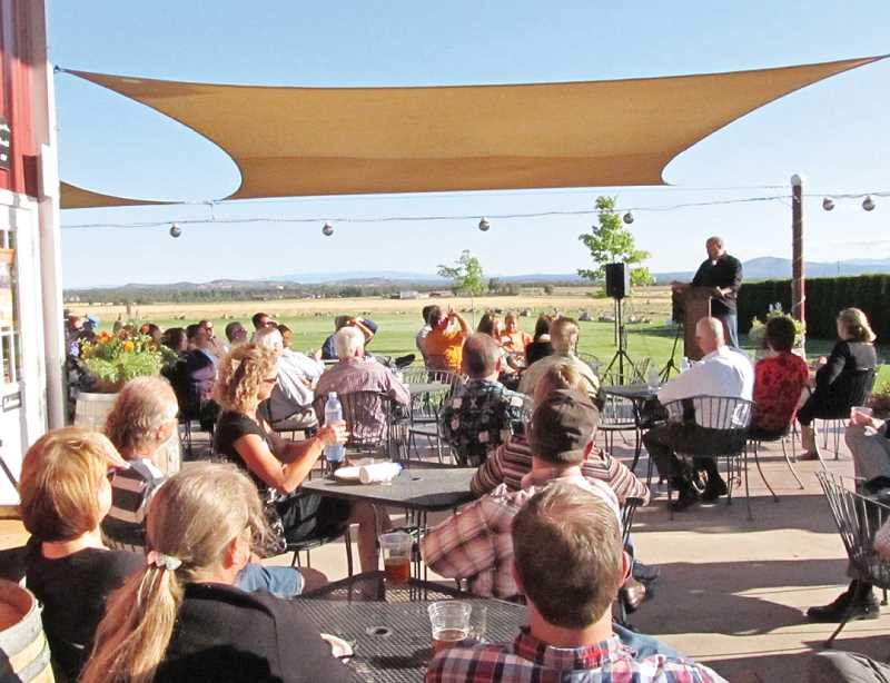 by: TOM BROWN - Aaron Luelling, of Las Vegas, speaks to the crowd at Jefferson County's first PubTalk at Maragas Winery on July 24. Luelling intends to move his business, Luelling Orchard Brewing Co., to Madras.