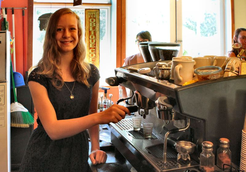 by: DAVID F. ASHTON - Linsey Haraldsen, freshman at Cleveland High School, is ready to make another cappuccino or espresso as part of the Café au Play barista job-skills training program.