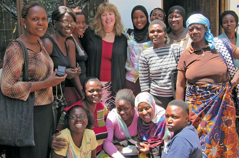 Photo Credit: COURTESY OF HEROIC IMAGINATION PROJECT - Portland Community College psychology professor Vivian McCann (center) recently talked to a group of women in Tanzania about becoming everyday heroes by standing up to authority. McCann is a trainer with the Stanford University-based Heroic Imagination Project.