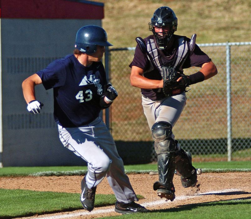 Photo Credit: DAN BROOD - RAN DOWN -- Sherwood catcher Adley Rutschman (right) runs down Lake Oswego's Joey Martin in Friday's winners' bracket final at the OIBA tournament held at Oregon City.