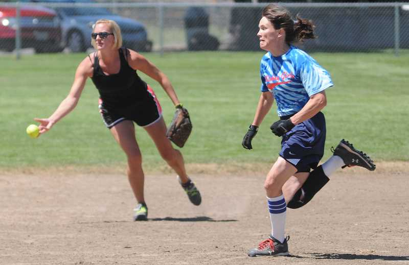 Photo Credit: LON AUSTIN/CENTRAL OREGONIAN - Marcinda Norris, who plays second base for the Mudslingers, tosses the ball to second for a force out of a base runner from Whiskey Girls. Whiskey Girls went on to win the contest.
