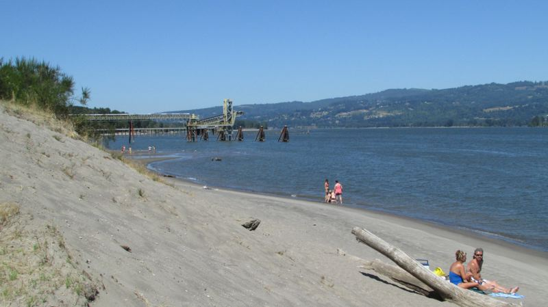 Photo Credit: MARK MILLER - Beachgoers at Trestle Beach flout the 'no trespassing' sign the Port of St. Helens posted at the unofficial trailhead to the riverside area. The beach was not crowded Tuesday afternoon, but despite the port's efforts, it was far from empty.