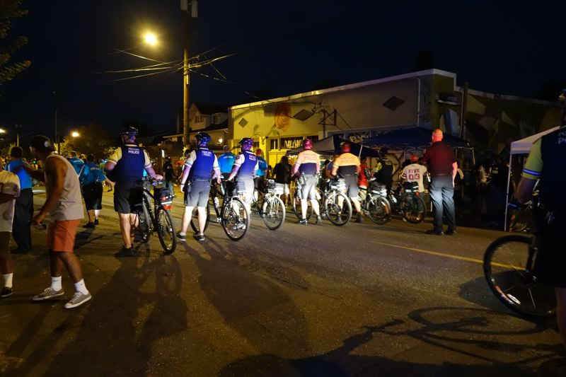 Photo Credit: JOSEPH GALLIVAN - Police and security guards end the art walk at 10 pm Northeast Alberta St on Thursday evening on July 31, 2014