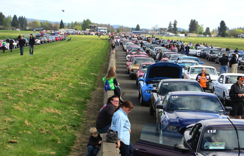 Photo Credit: CONTRIBUTED PHOTO - More than 900 Mustangs and Fords parked four abreast at the Woodburn Drag Strip.