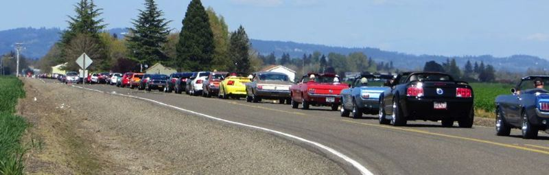 Photo Credit: CONTRIBUTED PHOTO - Cars follow the 9.5 parade route from the drag strip.