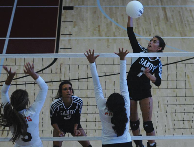 Photo Credit: SANDY POST: FILE PHOTO - Kayla Anderson rises above the net for a kill during a match last season. The Pioneers finished fifth in league with a 6-8 record in 2013.