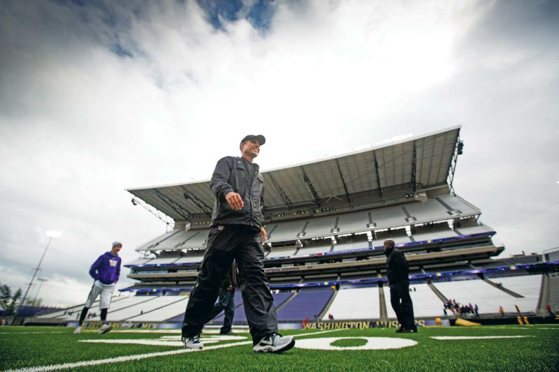 Photo Credit: COURTESY OF UNIVERSITY OF WASHINGTON - Chris Petersens arrival in Seattle after his success with Boise State has boosted the Washington Huskies hopes of contending for top honors and future glory in the Pac-12 North and beyond.