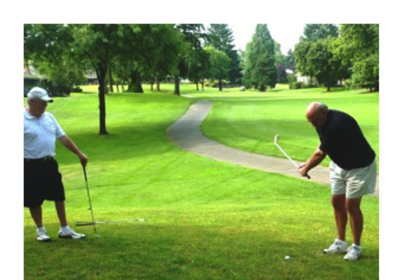 Photo Credit: SUBMITTED PHOTO - A man attempting a chip shot at Charbonneau Golf Club.