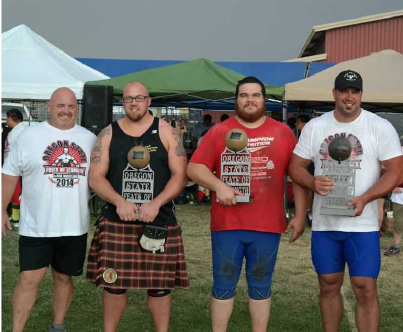 Photo Credit: PHOTO COURTESY OF DEAN MUNSEY - Molalla's Jeff Rose (far right) stands alongside event promoter Dean Muncey and fellow competitors Dan Moore and Ben Crutcher after win the open heavyweight division at Saturday's Oregon State Feats of Strength in Redmond.